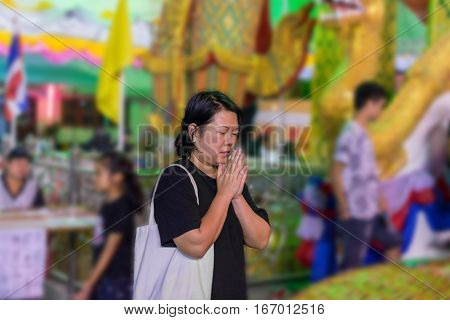 Thai buddhism people in buddhist pray for benefaction worship to Buddha in Thai temple