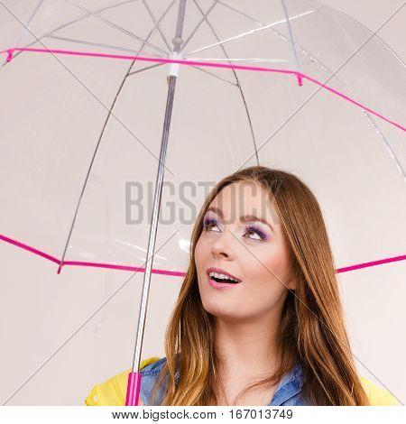 Woman Standing Under Umbrella