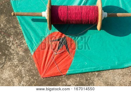 Kite and manja thread for kite fighting. This is a popular sport in Rajasthan and Gujrat during makar sankranti and uttarayan