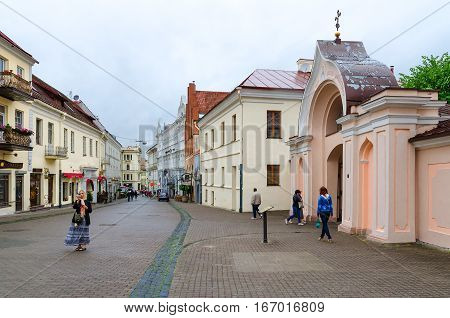 VILNIUS LITHUANIA - JULY 10 2015: Unidentified people are on Street Ausros Vartai near entrance to Holy Spirit Monastery in Old Town Vilnius Lithuania