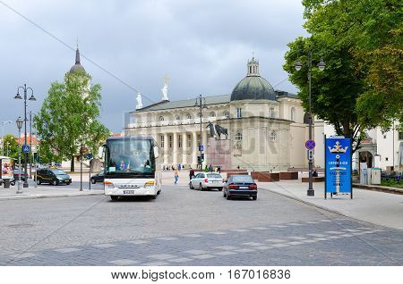 VILNIUS LITHUANIA - JULY 10 2015: Cathedral of St. Stanislaus and St. Vladislav Chapel of St. Casimir. Unidentified people walk on Cathedral Square