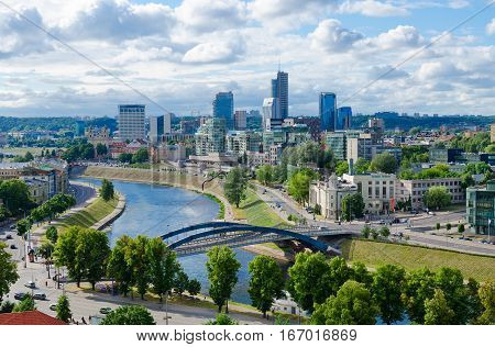 VILNIUS LITHUANIA - JULY 10 2015: View of River Neris and City high-rise buildings on right bank Vilnius Lithuania