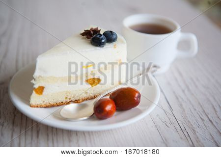 souffle cake with black berries on plate