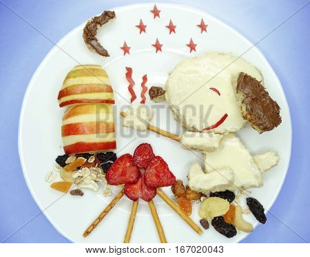 creative breakfast food with fruit and chocolate sweet cream on bread