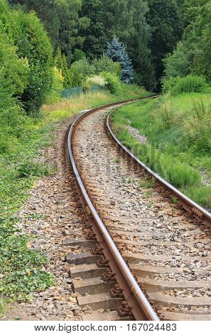A railway line disappearing into a curve