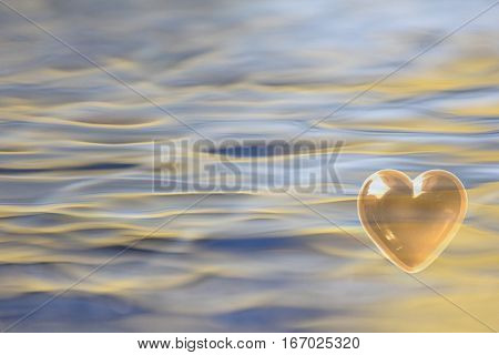 Gold Heart with soft focus water reflections