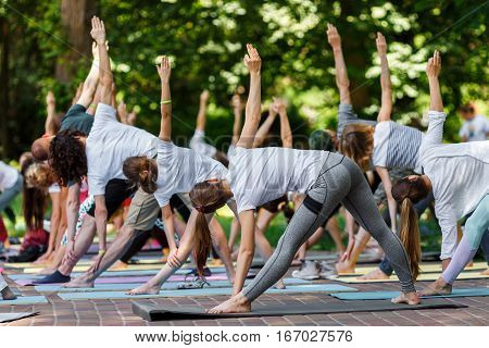 Group free yoga class for people of different age and gender in .