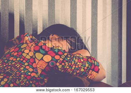 Asia woman plump body take a nap or sleep on a brown sofa Because fatigue or tired process in vintage style