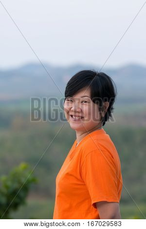 Asia Woman Posing And Smile At Mountain View