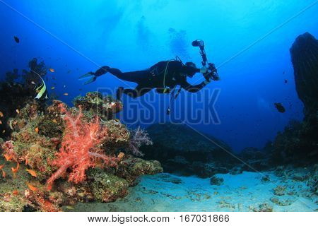 Underwater photographer. Scuba diver with underwater camera.