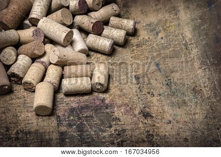 Bunch of wine corks on wooden table background
