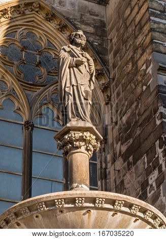 Cologne, Germany - January 19, 2017: Sculptural monument next to the cathedral. Cologne Cathedral ranked third in the list of the highest churches in the world and is listed World Heritage sites.