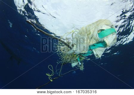 Plastic pollution in ocean. Discarded fishing nets in sea
