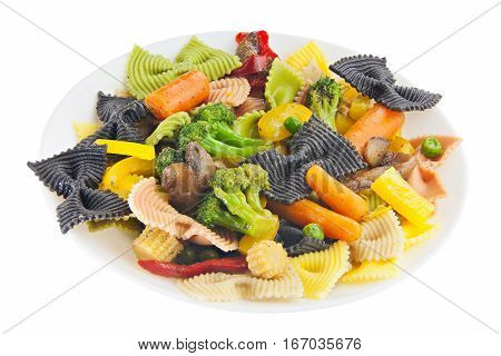 appetizing colored farfalle pasta with vegetables and mushrooms