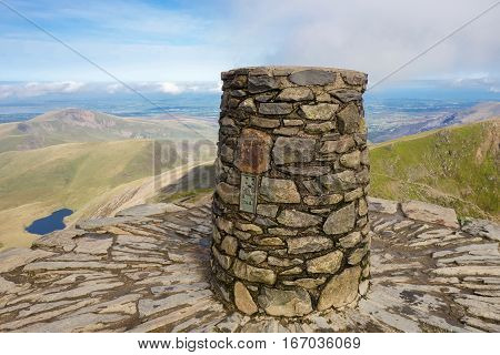 View from the top of the mountain, Snowdonia National Park, North Wales, United Kingdom; view of the mountains and the lakes, selective focus