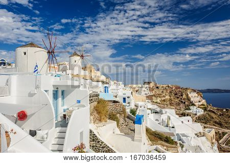 Oia, Santorini island, Greece - April 2016: view of famous windmill in Oia village just before high season start.