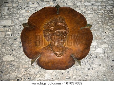Winchester, Hampshire, England - August 02: carved wooden portrait of Queen Elizabeth in the Great Hall in Winchester Castle, now is museum of the history of on August 02, 2015 in Winchester, Hampshire, England
