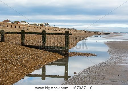 Low tide in Pevensey bay East Sussex England selective focus