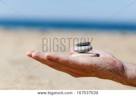 Photo of palm holding shingle in form of zen