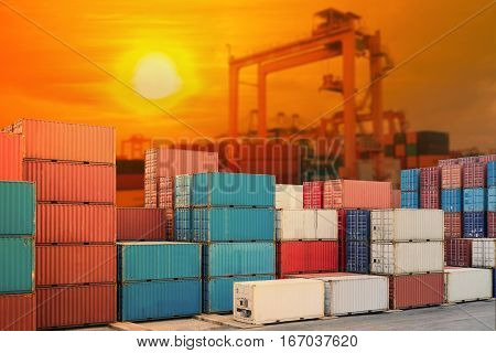 Industrial port with container yard and light shines sunset