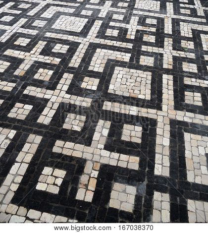 Typical Portuguese black and white stone mosaic