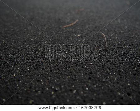 This closeup picture of the grains of a black sand beach in Hawaii makes an interesting background.