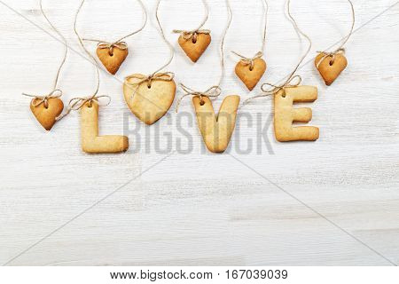 White Wooden Background With Homemade Cookies In The Shape Of A