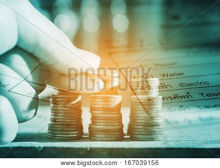Double exposure rows of coins with utility bill and account for finance and banking concept