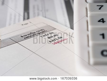 Save money concept Utility bill with calculator on paper background