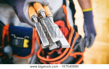 Hand Holding Set Of Chisels