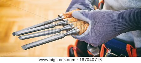Hands Holding Set Of Chisels