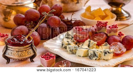Cheese. Assortment Of Appetizers. Fruit And Chocolates.