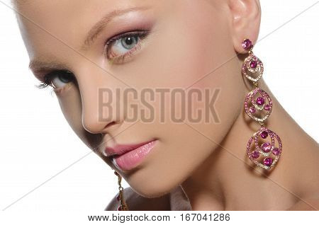portrait of beautiful woman with earrings isolated on white