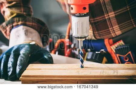 Worker Holding An Electric Drill