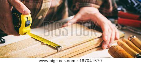 Carpenter Holding A Measure Tape