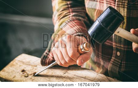 Carpenter Working With A Chisel