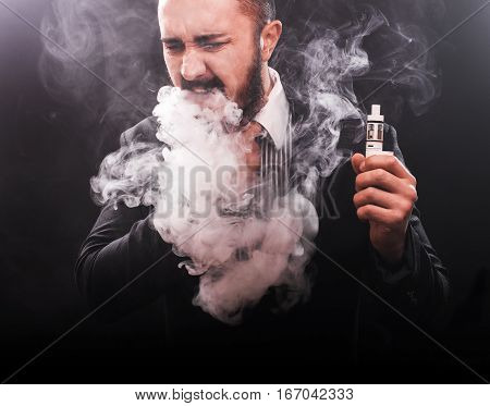 young man suffocating in vape smoke,vapor concept