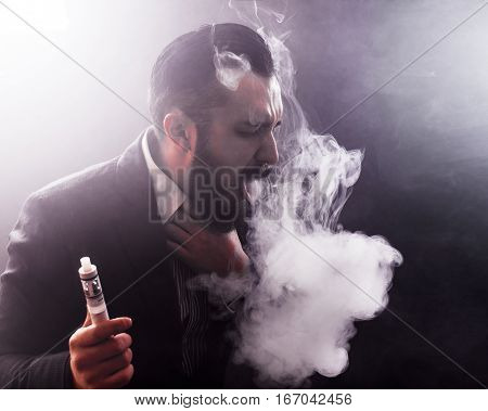 young man suffocating in vape smoke, vapor concept