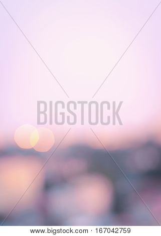 Abstract blurry bokeh background. Defocused and colorful light spots. Gold, pink, lilac pastel colors, vertical