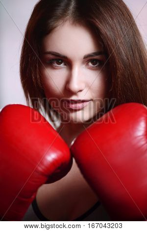 Woman In Boxing Gloves And Sportswear In Gym