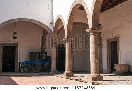 A courtyard in a museum with stylish arches and columns