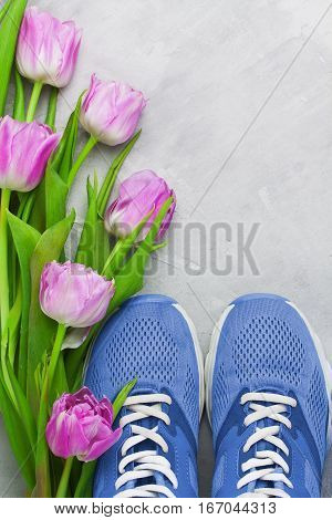 Spring Flatlay Sports Composition With Blue Sneakers And Purple Tulips.