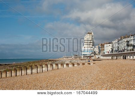 Hastings sea front in a low tide East Sussex England view to the west of the pier selective focus on the nearest sea groin
