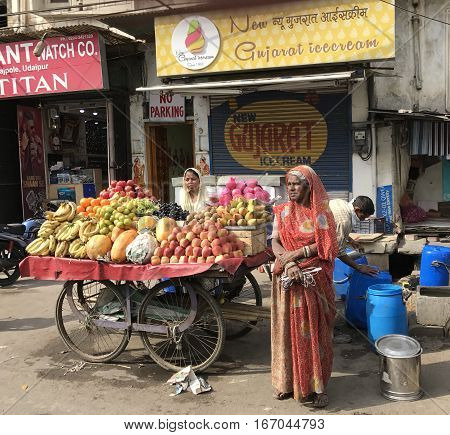 UDAIPUR INDIA - JANUARY 14 2017: Street Vendors with Fruit and Vegetable Cart. Many people make their living selling their wares from carts in the street.