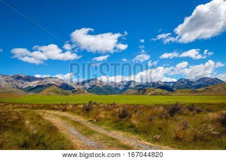 Beautiful Landscape View Of Mountains And Meadow, New Zealand