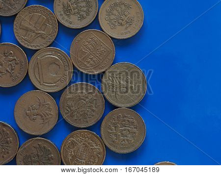One Pound (gbp) Coin, United Kingdom (uk) Over Blue With Copy Sp