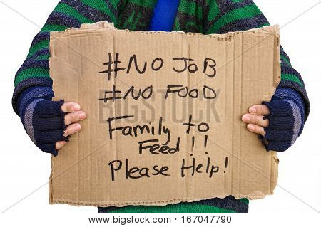 Homeless person holding a board asking for help
