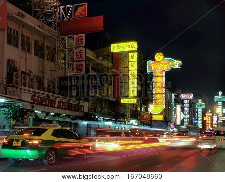 Chinatown Bangkok Thailand - January 28 2016: Cars and shops on Yaowarat Road in the evening the main street of town.