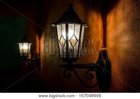 Vintage metal lantern. Old electric bulb. Iron Lamp.