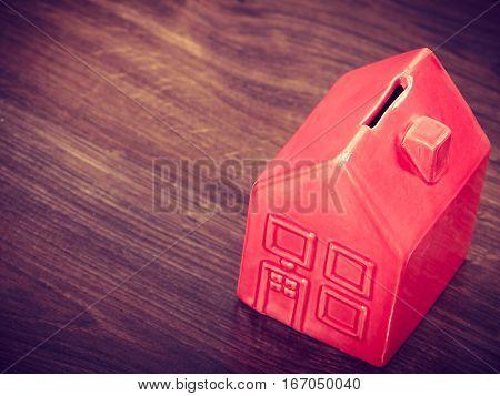 Finance mortgage housing real estate savings concept. House like cash box. Piggy bank in home shape.